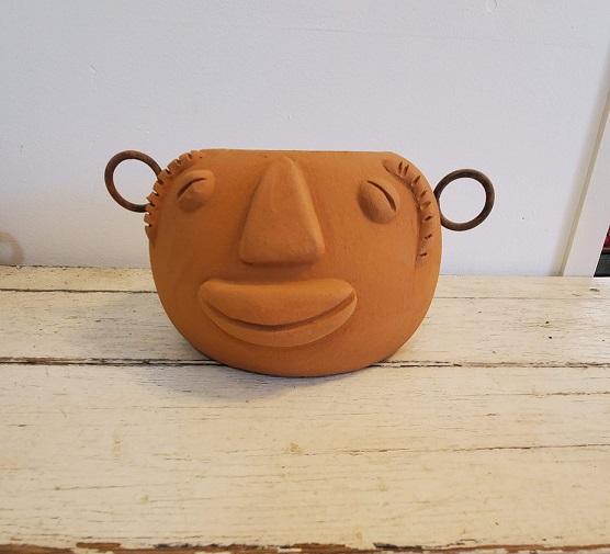Funky Face Pot Squat